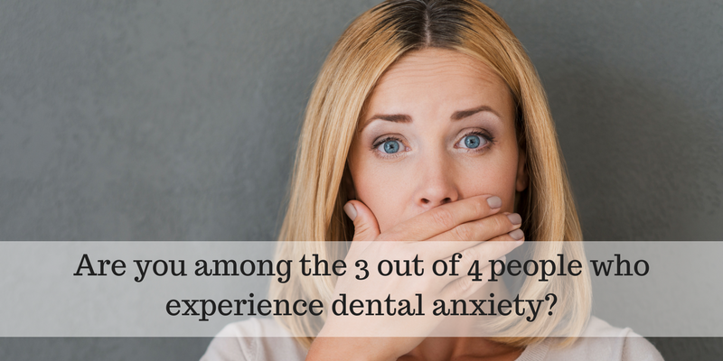 Woman with hand over mouth due to dental anxiety